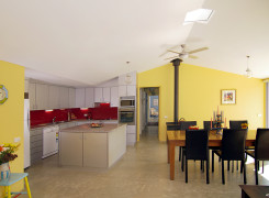 Open plan Kitchen and Dining with raked ceiling and Solar Chimney and Fan