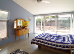 Bedroom with sliding glass doors to garden