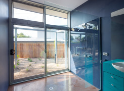 Northern ensuite with sliding glass doors to garden