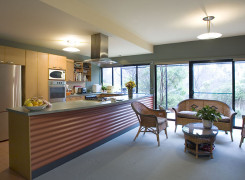 North facing open plan kitchen and family room with Strine signature corrugated backed metal island bench