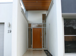 Timber lined entry canopy with walls acting as weather and privacy protection