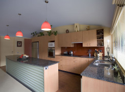 Efficient kitchen with Corrugated steel backed bench