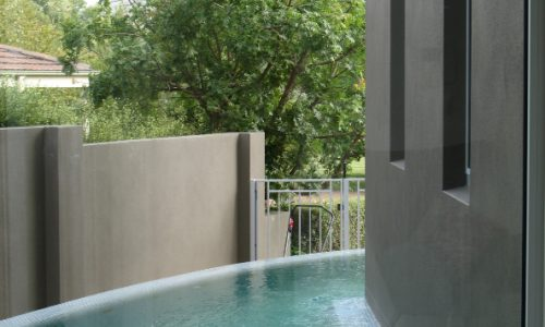 36 - Yarralumla Bay House - Sustainable house - Strine Design - side pool wrapping house