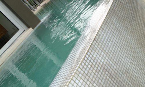 55 - Yarralumla Bay House - Sustainable house - Strine Design - pool wall
